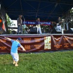 Callum Schofield, 2, dances during a performance by the Angelic Slugs at the first annual Jamaica Plain Music Festival on Aug. 20 at Jamaica Pond Park.
