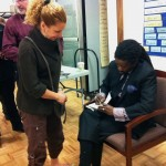 (Gazette Photo by Rebeca Oliveira) Rev. Osagyefo Sekou signs books after his March 7 reading at First Baptist Church.