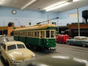 (Courtesy Photo) A 1/48 scale model trolley—about three inches tall—rolls along in the Bay State Model Railroad Museum's large space.