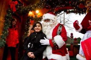 Jailanny Pena prepares to tell Santa Claus what she wants for Christmas during the annual holiday tree-lighting and Mayor's Enchanted Trolley Tour in Hyde Square on Dec. 8.  (Photo by Daniella Rascón)