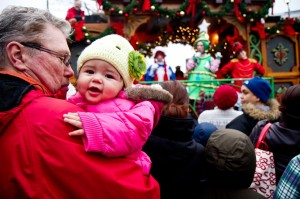 Baby Camila enjoys the crowd and lights in Hyde Square. (Photo by Daniella Rascón)