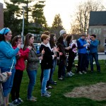People hold candles at the vigil April 17 at First Baptist Church. (Photo by Daniella Rascón)