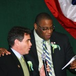 (Photo by Frederick G.S. Clow) City Councilor Tito Jackson (right), who represents Egleston Square and Parkside, joins fellow Councilor Frank Baker in song at the annual St. Patrick's Day Breakfast in South Boston on March 17.