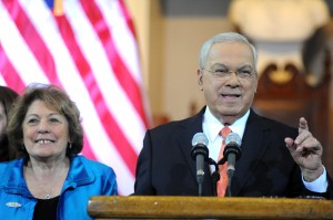 (Photo Courtesy Mayor's Office) Mayor Thomas Menino, with wife Angela at his side, announces he will not run for reelection at Faneuil Hall on March 28.