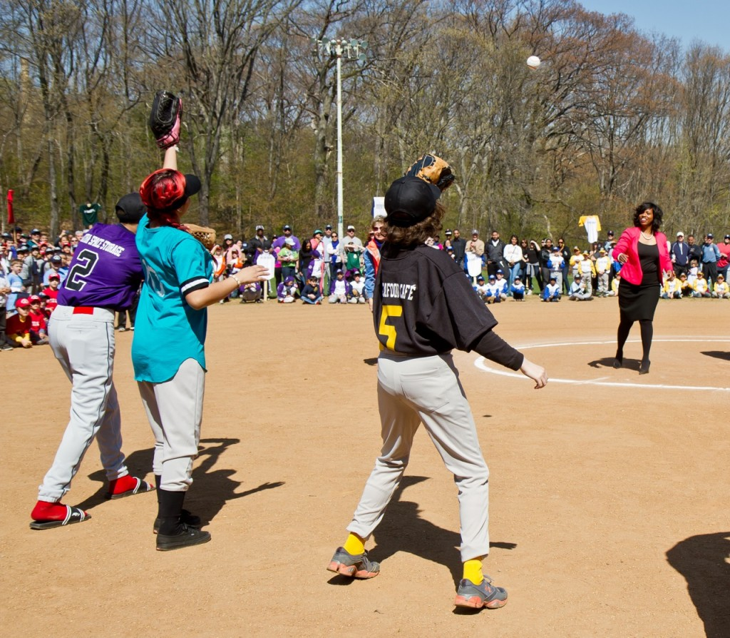 (Photo by Daniella Rascón) City Councilor Ayanna Pressley throws out the first pitch during the Opening Day ceremony for the JP Regan Youth League April 27 at Daisy Field in Olmsted Park on the Jamaicaway.