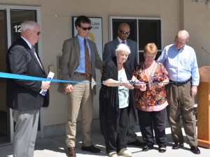 (Courtesy Photo) Mary Carroll, a 125 Amory St. resident, cuts the ribbon on the new PACE Adult Day Health Center at 125A Amory on June 1. Joining her were (from left) Upham's Corner Health Center CEO Edward Grimes; Dr. Adam Burrows of Upham's Elder Service Plan; PACE Site Director Jay Trivedi; Upham's board president Margaret Wirth; and Boston Housing Authority Administrator Bill McGonagle.