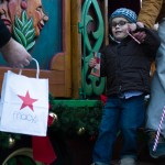 Young Mark Gemmett gets a gift at the Hyde Square tree-lighting. (Photo by Stacey Rupolo)