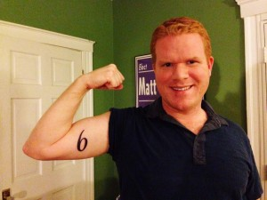 Councilor gets district number tattooed on arm