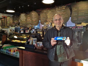 J.P. Licks owner Vince Petryk poses with a box of Oreos, whose brand will be stricken from flavor names. (Gazette Photo by Rebeca Oliveira)