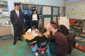 Mayor Martin Walsh (left) gets a tour from Waleska Landing Rivera (right), principal of JP's John F. Kennedy Elementary School, of the school's Acceleration Academy program on Feb. 19. The Boston Public Schools program offers students in low-performing schools one month of instruction in one week during the school vacation weeks. (Photo by Isabel Leon/Mayor's Office)