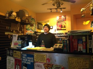 New Video Underground owner Kevin Koppes behind the counter on March 19. (Gazette Photo by Rebeca Oliveira)