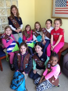 The girls of Jamaica Plain Brownie Troop 85074 visit the Home for Little Wanderers' Administrative Offices in the Symphony area on April 9 with donations of welcome bags they put together for kids who live in The Home's residential programs across Boston and Eastern Massachusetts. (Photo by Heather MacFarlane)