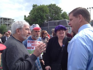 Mayor Martin Walsh (right) speaks to Bridging Forest Hills members (from left.) Kevin Moloney, Jeffrey Ferris and Lynn McSweeney. (Gazette Photo by Rebeca Oliveira)