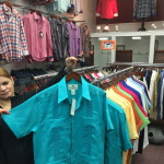 Mayra Franco shows off one of the guayaberas available at Centre Fashion last week. (Gazette Photo by Rebeca Oliveira)