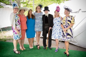 (from left) Julie Crockford, president of the Emerald Necklace Conservancy, joins Holly Safford; Kim Furnald; Camille Valentine; JP resident and Frederick Law Olmsted actor Gerry Wright; Lynn Dale; and Cackie Austin at the ENC's annual Party in the Park fundraiser May 13 at Jamaica Pond Park. The luncheon, which drew more than 700 people, raises money for the Justine Mee Liff Fund, named for the late Boston Parks Department commissioner and JP resident, which benefits Emerald Necklace parks. (Courtesy Photo)